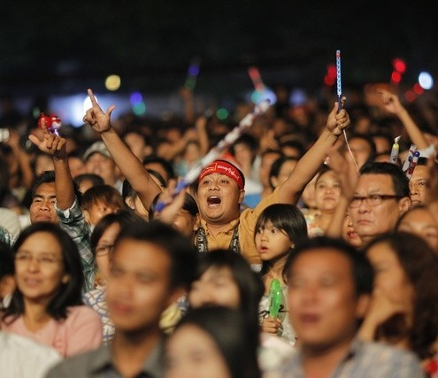 Supporters-wave-their-hands-during-music-show-for-Fund-Raising-campaign-National-League-of-Democracys-Education-Network-at-Yangon