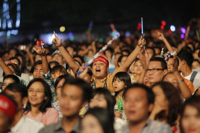 Supporters wave their hands during a music show for Fund Raising campaign National League of Democracy's Education Network at Rangoon. (Reuters)