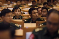 Representatives from the military members of parliament attend the opening of a joint parliament session in Naypyidaw on 4 July 2012. (Reuters)