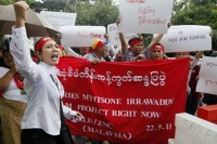 Burmese activists chant at a protest against the Myitsone dam project in Malaysia, 2013 (Photo: Reuters)