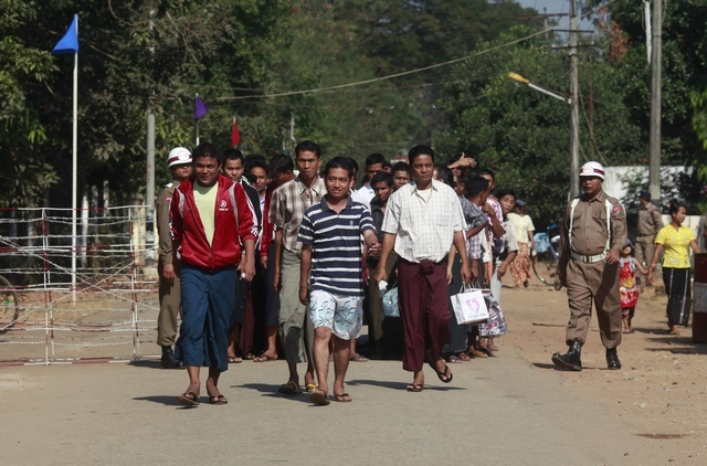 Prisoners come out from Insein prison after authorities released them in Rangoon on 3 January 2012. (Reuters)
