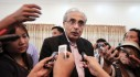 UN special Vijay Nambiar talks with reporters after visiting a refugee camp in Meikhtila