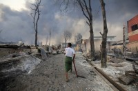 A man walks through the rubble in Meikhtila township after Buddhist mobs razed the area (Reuters)