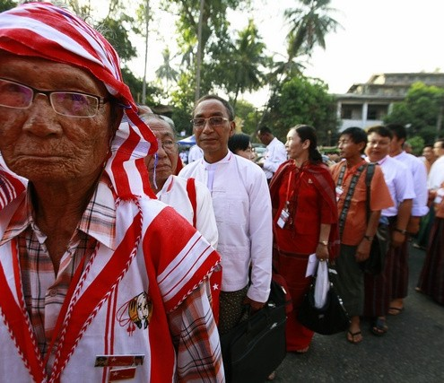 Congress delegates line up to register and attend the NLD party congress in Yangon