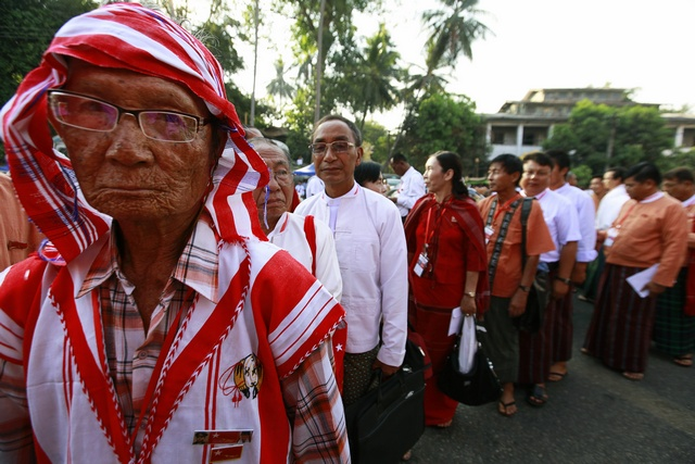 Congressional delegates line up to register and attend the National League for Democracy party's congress in Rangoon on 8 March 2013. (Reuters)