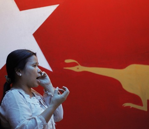 A party member talks on the phone at the office of the NLD in Yangon