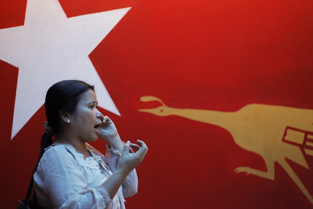 A party member talks on the phone at the office of the National League for Democracy (NLD) in Rangoon on 5 March 2013. (Reuters)