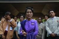 Aung San Suu Kyi talks to reporters during a news conference after she attended the National League for Democracy party's (NLD) congress in Rangoon on 10 March 2013. (Reuters)
