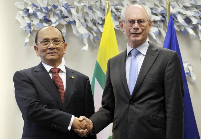 European Council President Herman Van Rompuy (R) welcomes Burmese Prime Minister Thein Sein at the European Union Council in Brussels on 5 March 2013. (Reuters)