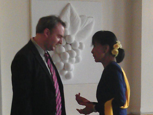 In this file photo, Andy Hall speaks with Aung San Suu Kyi in Rangoon, December 2012. (Photo: Andy Hall)