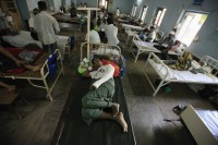 Patients who were injured in a recent riot are seen at a hospital in Meikhtila
