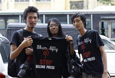 Journalists pose in t-shirts during a protest along the streets of Rangoon in August 2012. (Reuters)