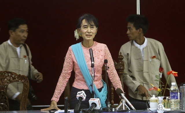 Aung San Suu Kyi talks to reporters as the leader of a special investigation commission for Latpadaung copper mining during a news conference in Rangoon on 6 December 2012. (Reuters)