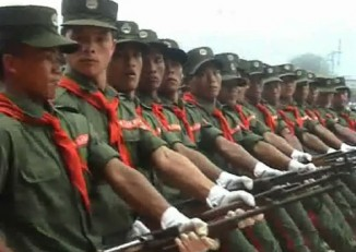 File photo of United Wa State Army troops march during a military parade. (Photo: DVB)