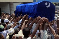 Muslims carry the coffin of a victim of a fire during a funeral at Yaeway cemetery in Rangoon on 2 April 2013. (Reuters)
