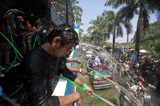 People play with water as they celebrate Thingyan in Yangon