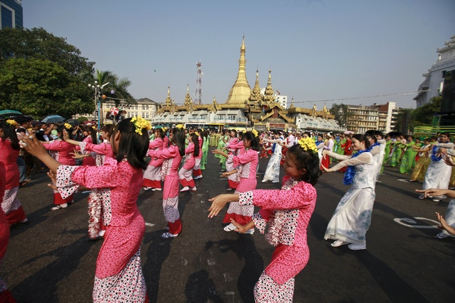 Performers dance at the opening ceremony of a water pavilion during celebrations to mark Thingyan in Yangon