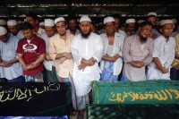 File photo of Muslims attending a funeral for victims of a fire at Yaeway cemetery in Rangoon on 2 April 2013. (PHOTO: Reuters)