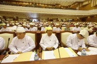 In this file photo, members of parliament attend the opening of the lower house session in Naypyidaw on 4 July 2012. (Photo: Reuters)