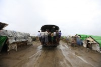 A vehicle carries people to a safer place from Cyclone Mahasen at a Rohingya internally displaced persons (IDP) camp outside of Sittwe on 16 May 2013. (Reuters)