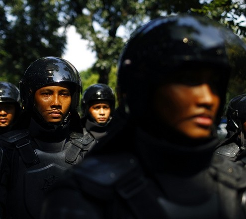 Indonesian policemen are deployed outside the embassy of Myanmar during a protest by Indonesian Muslim hardline groups in Jakarta