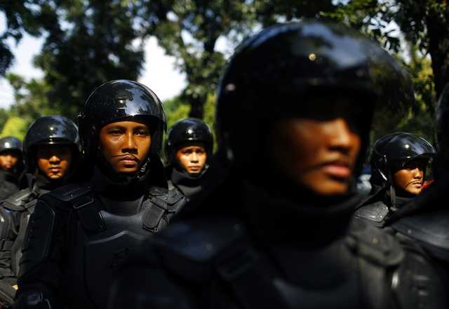 Indonesian policemen are deployed outside the Burmese embassy during a protest by Indonesian Muslim hardline groups in Jakarta (Reuters)