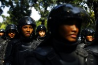 FILE PHOTO: Indonesian policemen are deployed outside the Burmese embassy during a protest by Indonesian Muslim hardline groups in Jakarta (PHOTO: Reuters)