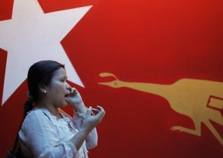 File photo of an NLD party member at the office of the National League for Democracy (NLD) in Rangoon, March 2013. (Reuters)