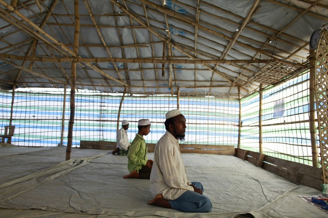 In this file picture from May, Muslim men offer Friday prayers in a makeshift mosque in Sittwe, Arakan state. (PHOTO: Reuters)