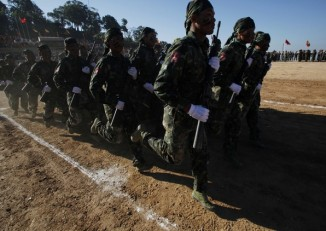 Shan State Army-South soldiers march during the 65th anniversary of Shan State National Day at the army's Loi Taileng headquarters along the Burmese-Thai border on 7 February 2012. (Photo: Reuters)