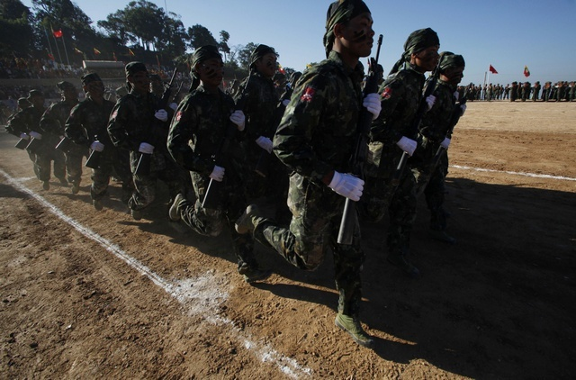 Shan State Army-South soldiers march during the 65th anniversary of Shan State National Day at the army's Loi Taileng headquarters along the Burmese-Thai border on 7 February 2012. (Reuters)