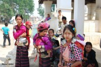 Displaced ethnic villagers standing outside a monastery in Tangyan town, northern Shan State (PHOTO: SHRF)