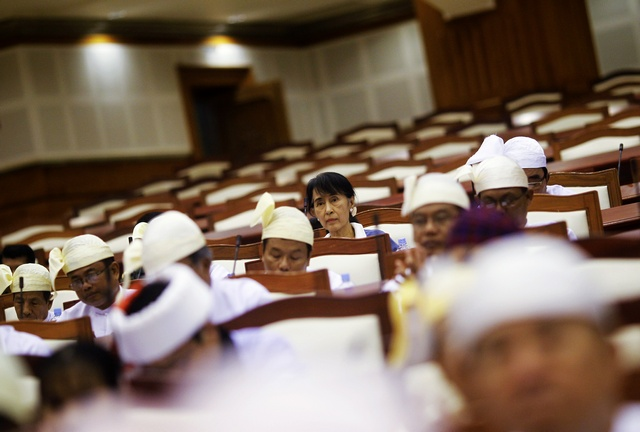 Aung San Suu Kyi attends a parliament meeting in the Lower House of Parliament in Naypyidaw on 6 August 2012. (PHOTO: Reuters)