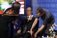 Voice of America staff set up a microphone and clean the suit of Burmese President Thein Sein before a town hall event at the Voice of America in Washington on 19 May 2013. (Reuters)
