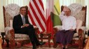 U.S. President Barack Obama smiles as Myanmar's President Thein Sein waves during their meeting in Yangon