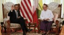 U.S. President Obama waves to the press during his meeting with Myanmar's President Thein Sein in Yangon
