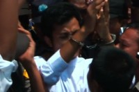 Ye Min Oo speaks to reporters outside of Western Rangoon District Courthouse on 4 April 2013. (DVB)