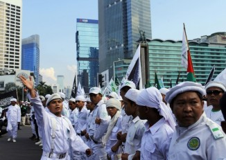 People from Indonesian Muslim hardline groups gather during a protest near the embassy of Myanmar in Jakarta