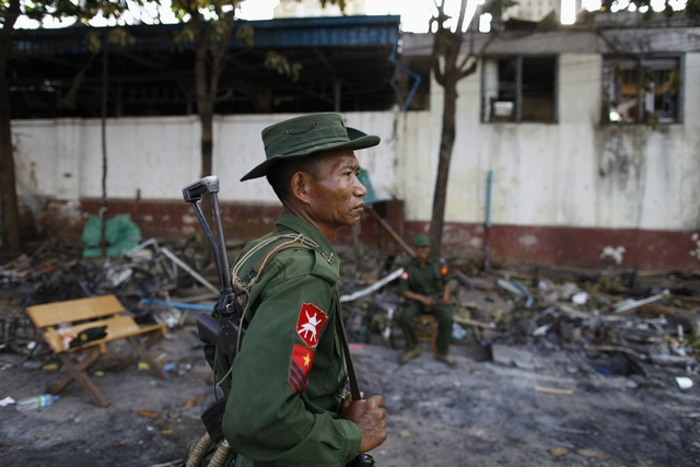 In the town of Lashio in May, a similar outbreak of violence saw dozens of Muslim houses and shops burnt down. In this file photo, a soldier stands guard in front of a mosque that was torched during the riot. (Reuters)