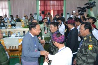 Kachin Indepence Organisation and government representatives shake hands during the latest round of peace talks in the Kachin state capital of Myitkyina on 28 May 2013. (DVB)