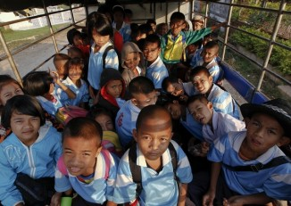 File Photo: Young students ride to school in Mon State. (Reuters)