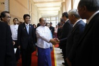 Burma's President Thein Sein (C) shakes hands with Japanese businessmen as they are introduced by Japan's Prime Minister Shinzo Abe at the Myanmar International Convention Centre in Naypyidaw on 26 May 2013. (Reuters)