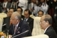 Burma's President Thein Sein (R) and Malaysia's Prime Minister Najib Razak (rear L) attend the 20th ASEAN summit meeting in Phnom Penh on 4 April 2012. (Reuters)