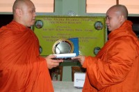 "In February 2013, Wirathu (right) received a controversial ""freedom of religion"" award in Mandalay. (DVB)"