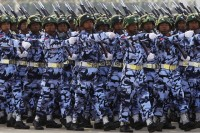 A guard of honour contingent marches during a parade to mark the 68th anniversary of Armed Forces Day in Myanmar's capital Naypyidaw on 27 March 2013.  (Reuters)