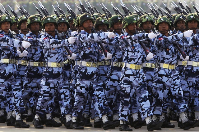 A guard of honour contingent marches during a parade to mark the 68th anniversary of Armed Forces Day in Burma's capital Naypyidaw on 27 March 2013.  (Reuters)