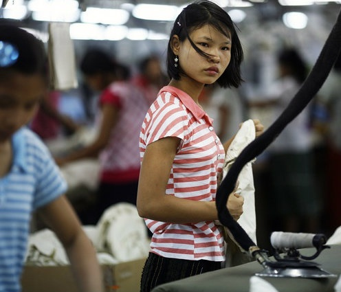 A worker looks on at a garment factory at Hlaing Tar Yar industrial zone in Rangoon. (PHOTO: Reuters)