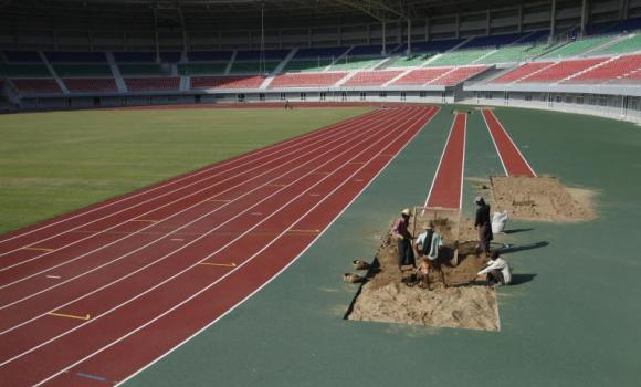 Labourers work on a stadium that is being built for the 2013 Southeast Asian Games in Naypyidaw. (Reuters)