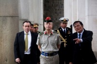 Britain's Chief of Defence Staff, Gen David Richards, center, visits the Htauk Kyant war cemetery in Rangoon on 4 June 2013 (Reuters)