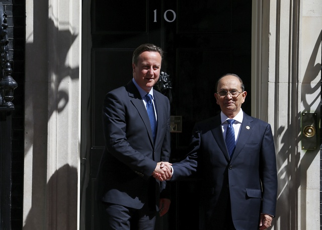 Britain's Prime Minister David Cameron greets the President of Burma Thein Sein in Downing Street, London, 15 July 2013 (Reuters)